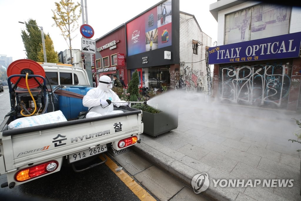 A street in Itaewon, a major nightlife district in Seoul, is disinfected to prevent the spread of COVID-19 on Oct. 31, 2020, the day of Halloween. (Yonhap)