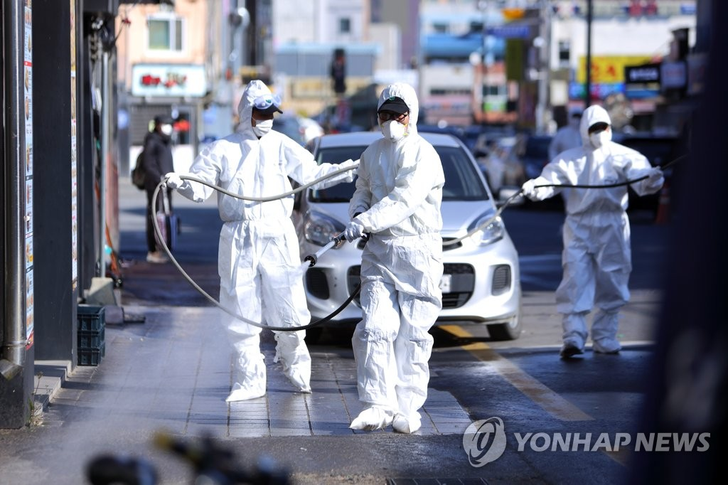 Officials carry out disinfection operations in Inje, 165 kilometers east of Seoul, on Nov. 12, 2020, in this photo released by Gangwon Province. (PHOTO NOT FOR SALE) (Yonhap)