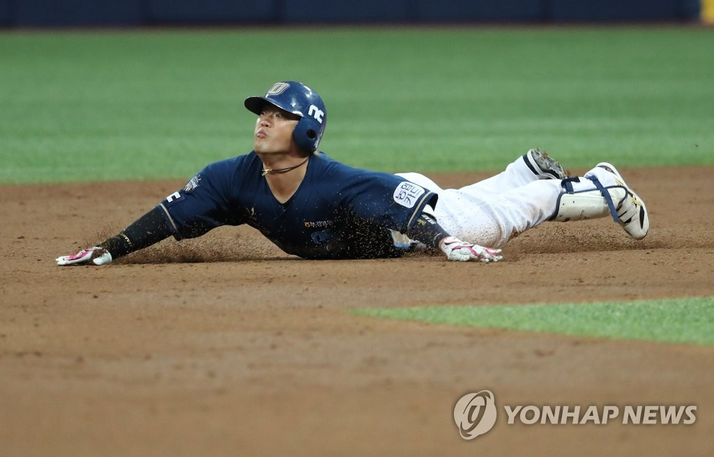 Park Sok-min of the NC Dinos slides into second base against the Doosan Bears in the top of the third inning of Game 3 of the Korean Series at Gocheok Sky Dome in Seoul on Nov. 20, 2020. (Yonhap)