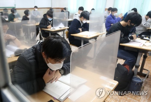 Nat'l college entrance exam gets under way as virus surges