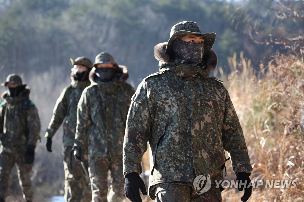 Military officials search for remains of wild boars in Yangyang, 215 kilometers east of Seoul, on Jan. 8, 2021, in this photo provided by the Army. (PHOTO NOT FOR SALE) (Yonhap)
