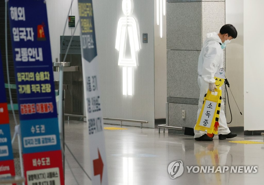 This photo taken on April 20, 2021, shows a health worker disinfecting a restroom inside Incheon International Airport in Incheon, west of Seoul. (Yonhap)