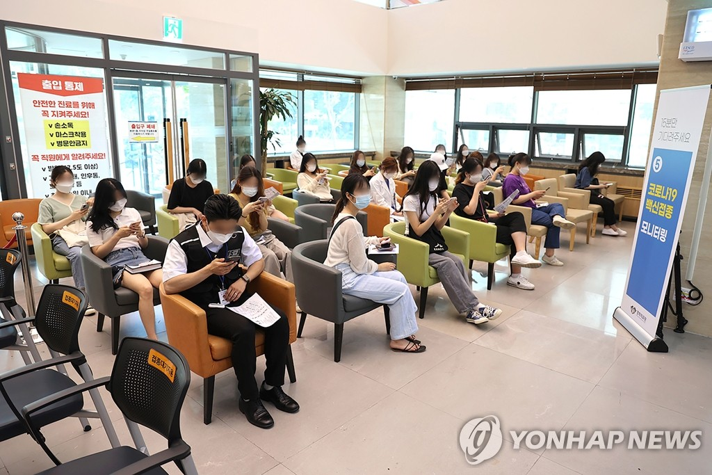This photo taken on June 21, 2021, and provided by Kyunhee University Medical Center, shows people waiting to receive the Moderna vaccine in eastern Seoul. (Yonhap)